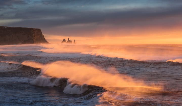 Huge waves roll in from the Atlantic ocean on the black sands of Iceland's South Coast.