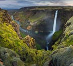 Scenic waterfalls and luscious flora can be found in the otherwise barren highlands of Iceland.