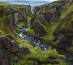 Fjaðrárgljúfur Canyon is approximately 100 metres deep.