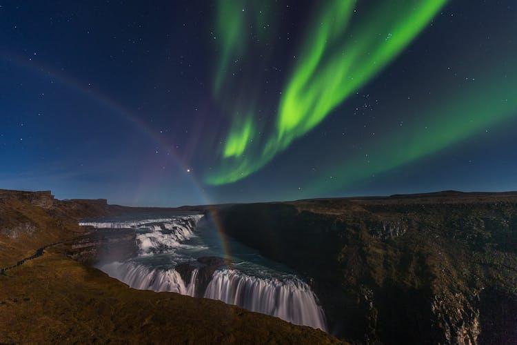 The aurora dance over Gullfoss waterfall.