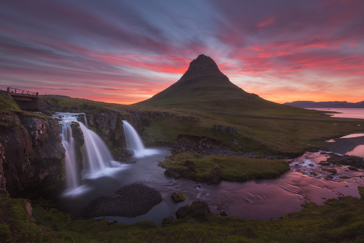 The Snæfellsnes peninsula boasts many gorgeous natural features and it is often referred to as 'Iceland in Miniature' for this reason; here, you can see the beautiful Mount Kirkjufell in the warm colourful glow of sunset.
