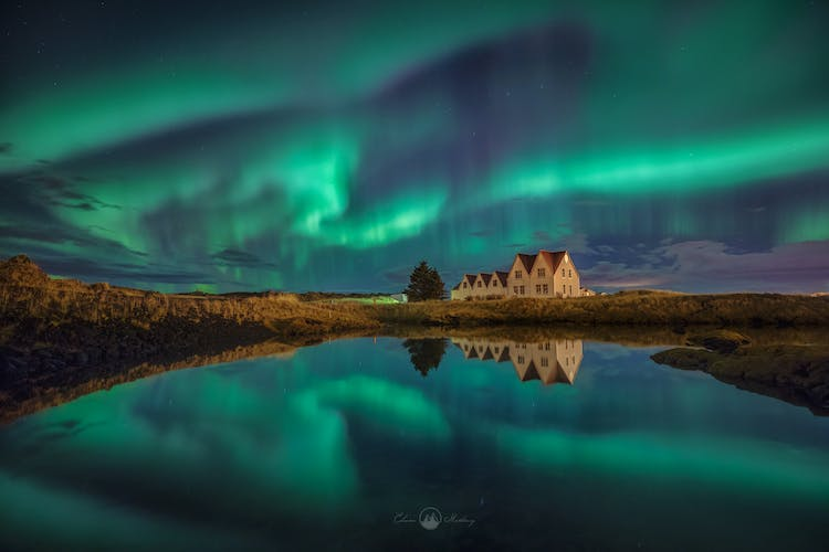 Dazzling Northern Lights paint the sky above Þingvellir National Park.