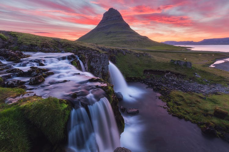 The pretty waterfall Kirkjufellsfoss serves as a perfect foreground subject to capture the majesty of Mount Kirkjufell.
