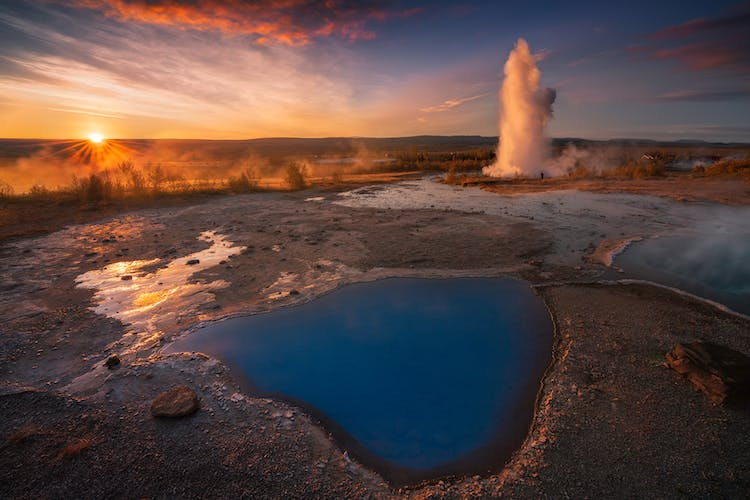 A geyser explodes at Haukadalur Geothermal Valley, on the Golden Circle sightseeing route in Iceland.