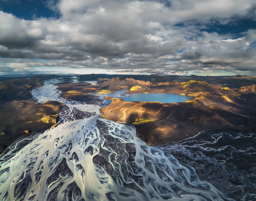 Aerial view of braided river system - Photo by Iurie Belegurschi