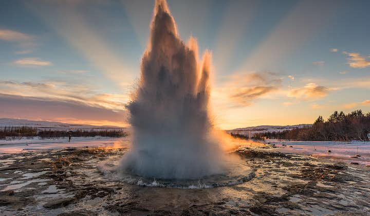 Capture the moment the hot spring Strokkur erupts at Geysir geothermal area.