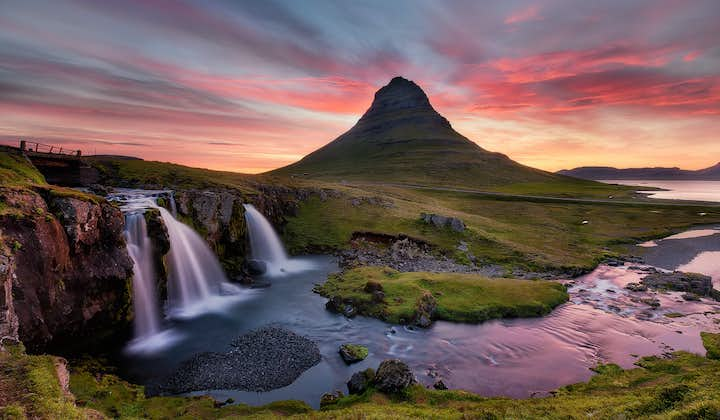 One of the jewels in the crown of the Snæfellsnes peninsula is the photogenic Mount Kirkjufell, especially under the colourful shades of the Midnight Sun.
