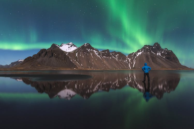 Northern Lights dancing over the dramatic Vestrahorn mountain.