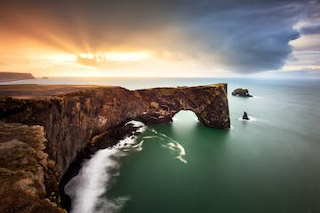 dyrholaey iceland vik reynisdrangar sunrise beautiful landscape rock hole.jpg