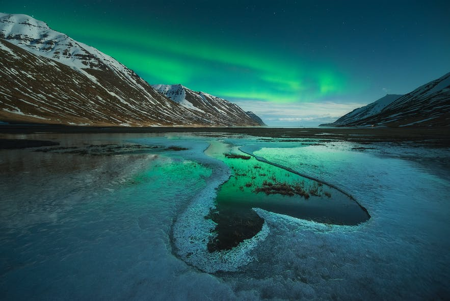 Northern Lights in the fjords. Photo by: 'Kaspars Dzenis'.