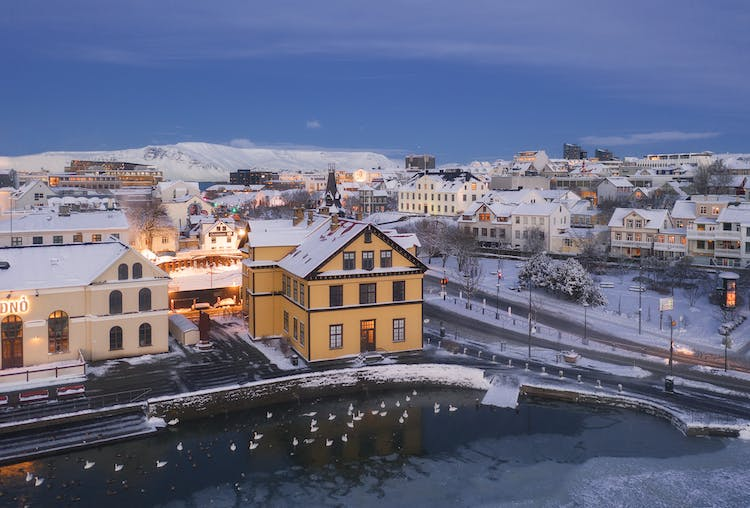 Tjörninn pond in downtown Reykjavík freezes over in the winter and it is particularly romantic when it's also covered in snow.