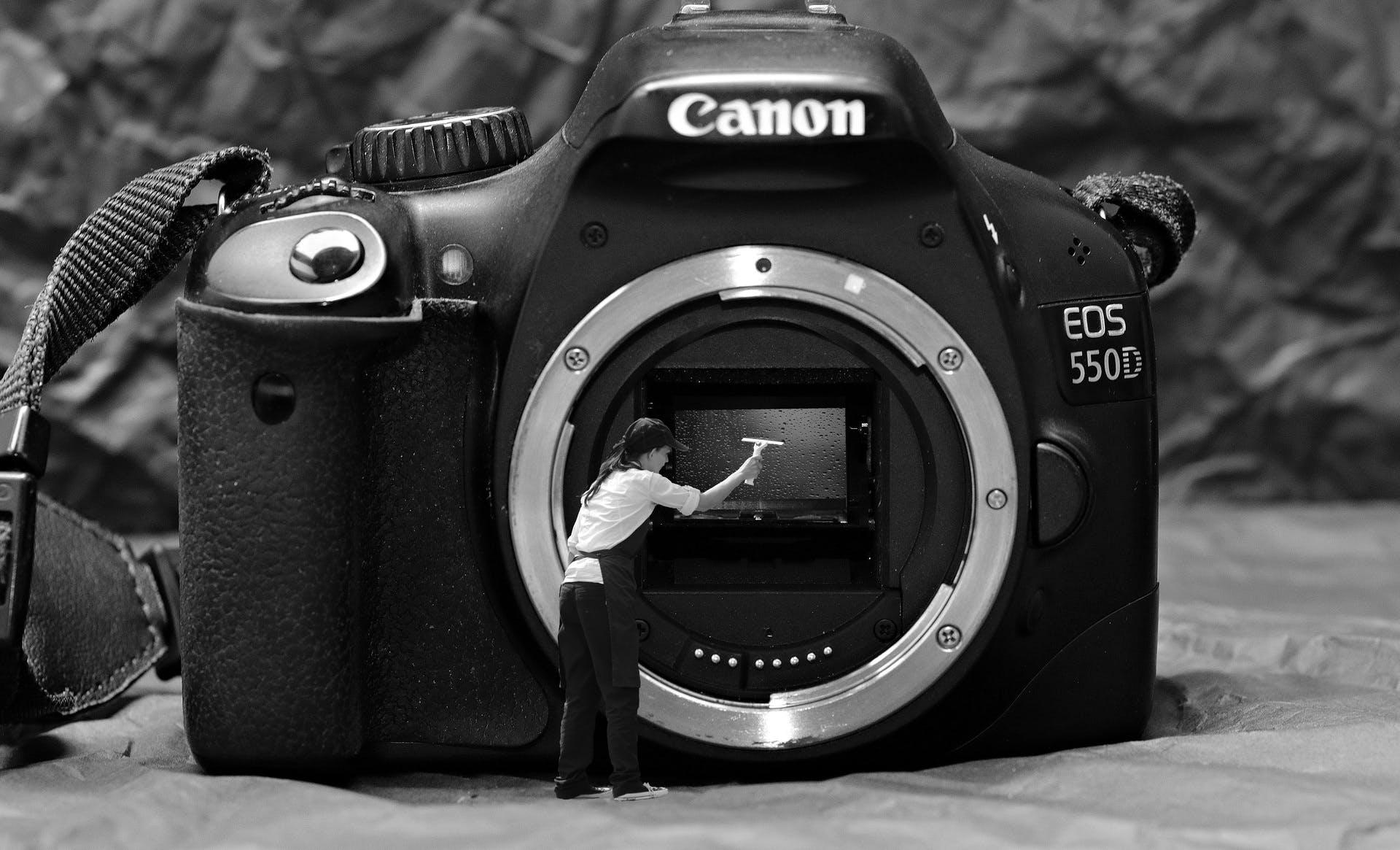 black-and-white-woman-white-camera-photography-wet-1279155-pxhere.com.jpg