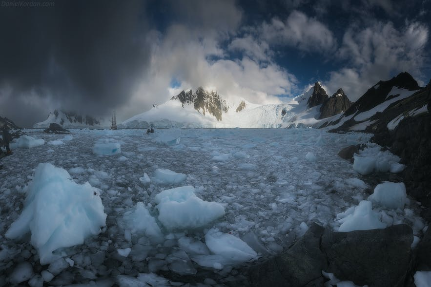 Storm clouds close in on an Antarctic landscape.