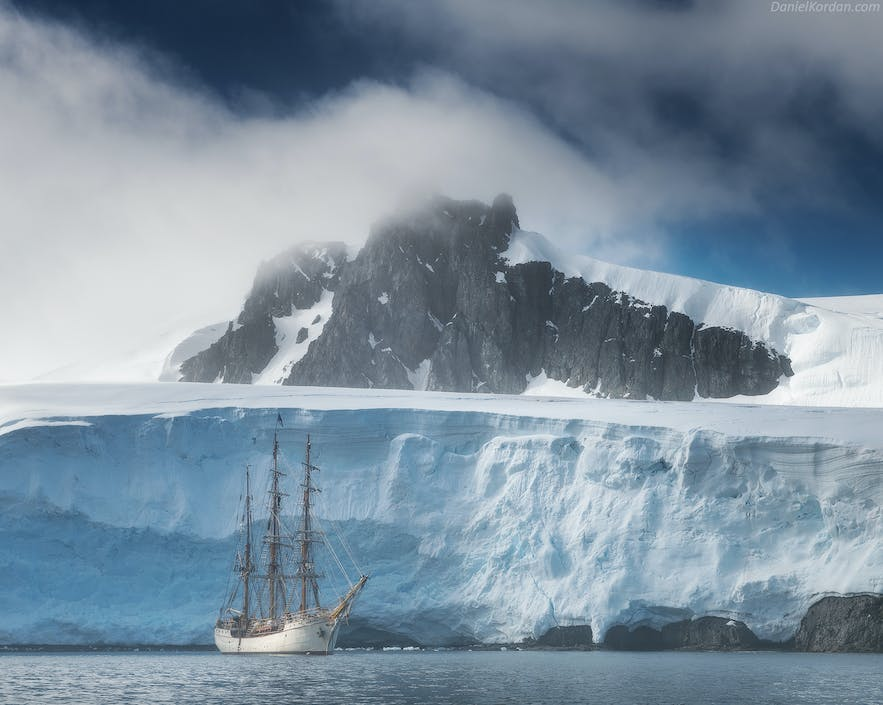 The Greg Mortimer sails along the Antarctic ice shelf.