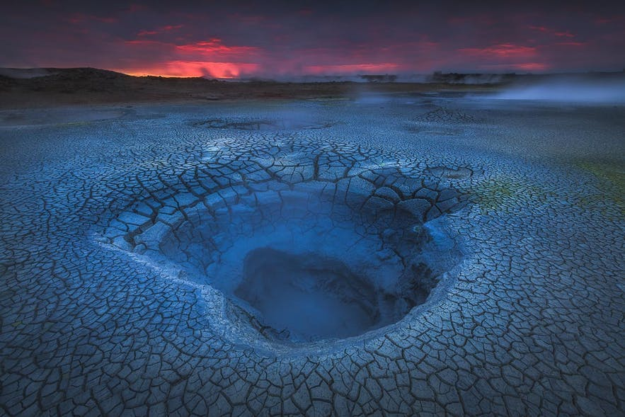 A pocket of geothermal water sits on a cracked, Icelandic landscape - Iceland Photography | Everything You Need To Know
