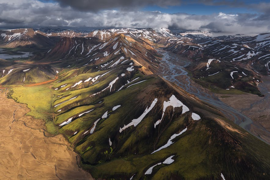 An aerial photograph of a river running through Icelandic highlands - the Iceland Photography | Everything You Need To Know