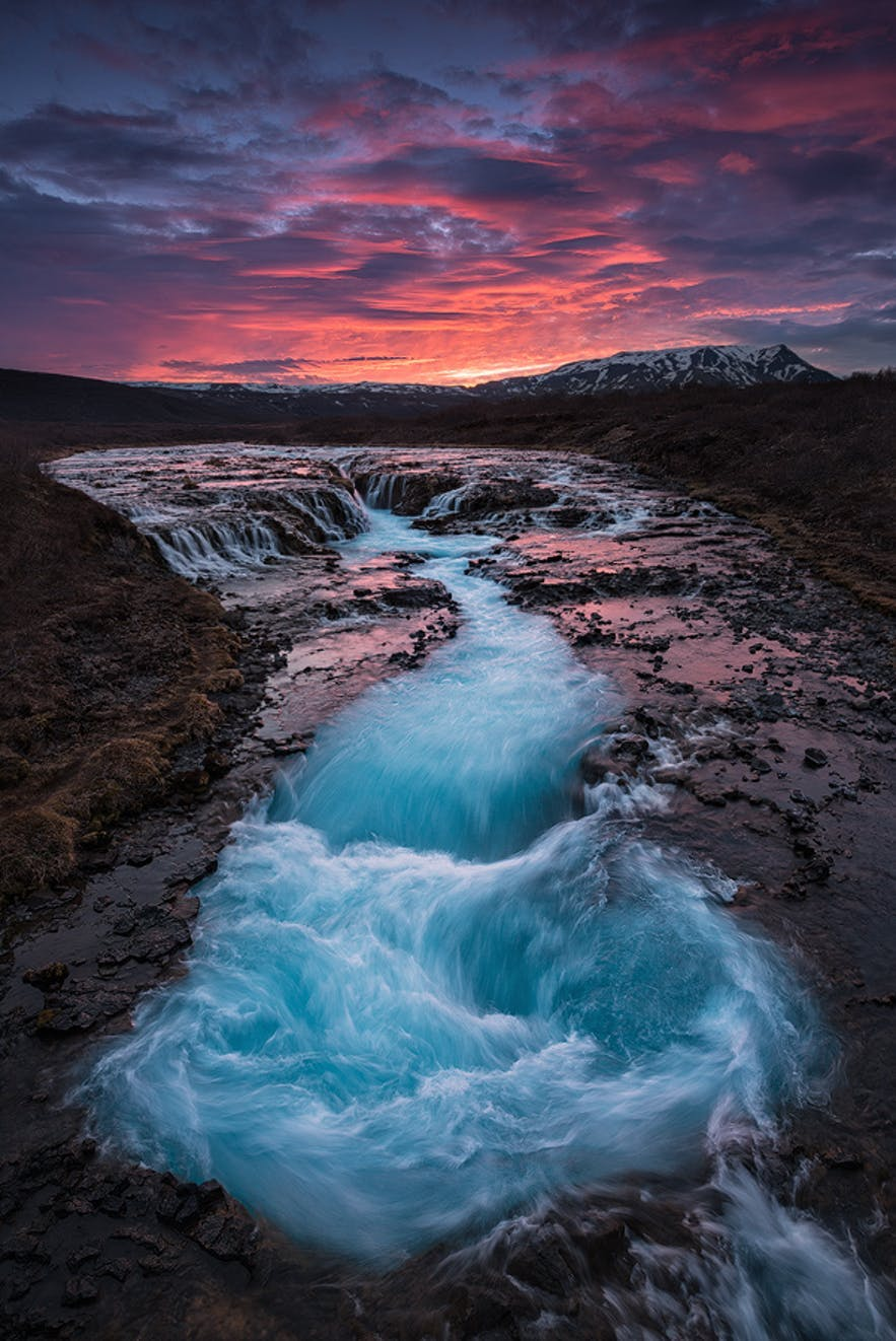 Waterfalls pool together underneath a midnight sun - Iceland Photography | Everything You Need To Know