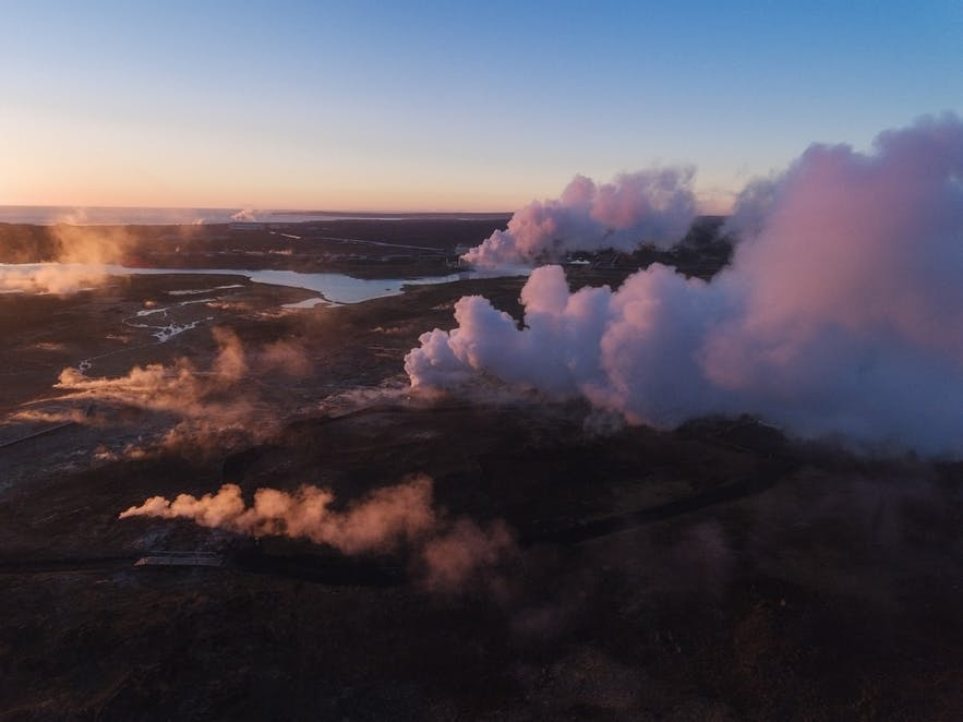 Steam from Geothermal pools raise from the Icelandic landscape - Iceland Photography | Everything You Need To Know