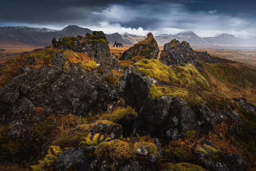 A church sits between rocks in an Icelandic landscape - Iceland Photography | Everything You Need To Know