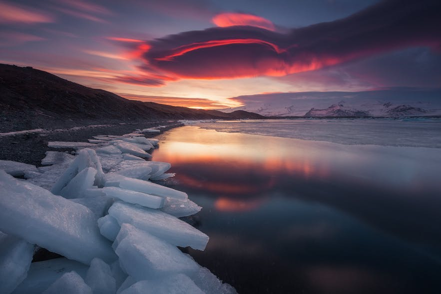 The sunsets over a coastal landscape with fresh blocks of ice - landscape Photography | Everything You Need To Know