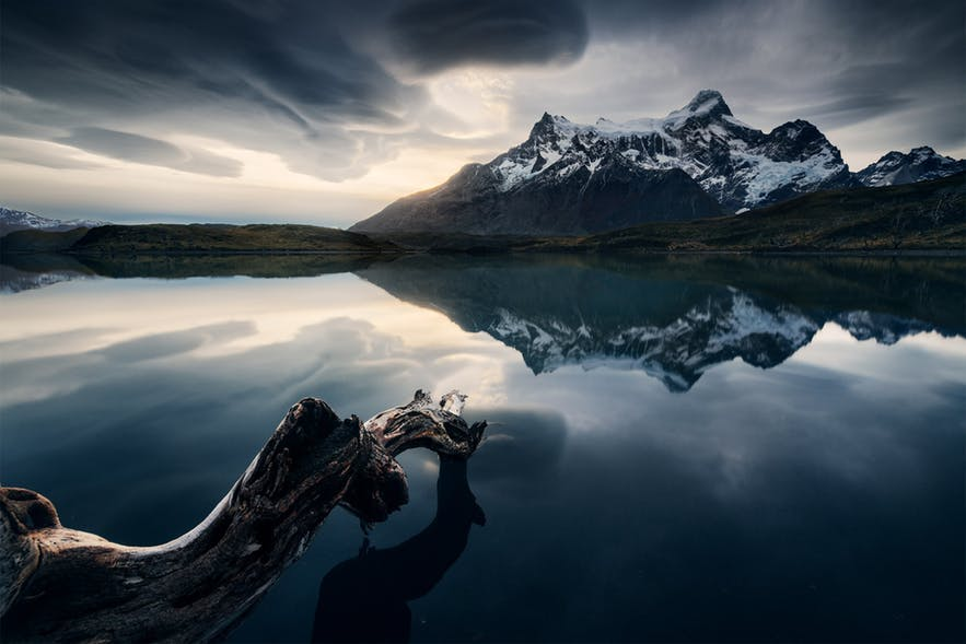 A large lake becomes a mirror in a mountainous region - landscape Photography | Everything You Need To Know