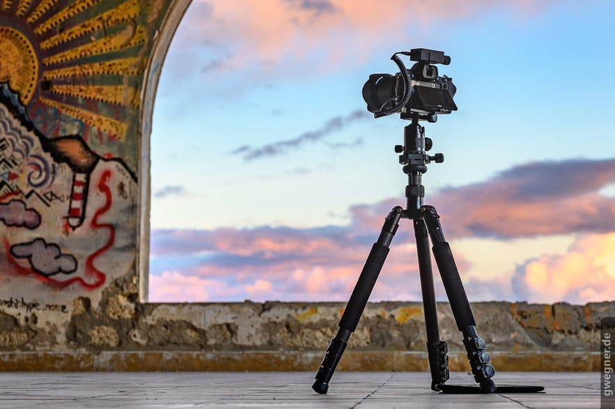 A camera and tripod sit in a location, ready to capture a landscape scene - landscape Photography | Everything You Need To Know