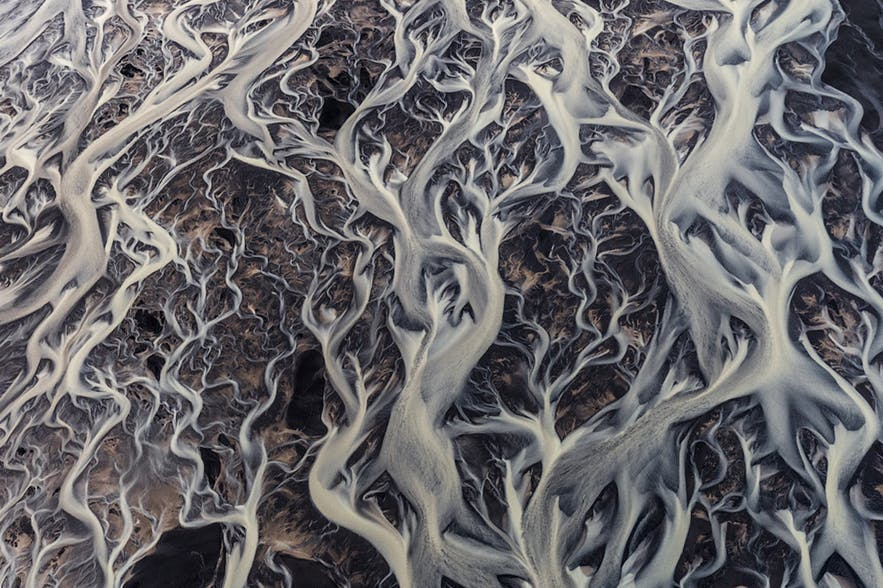 A glacier is seen from above in varying sized and shaped wavy lines - landscape Photography | Everything You Need To Know