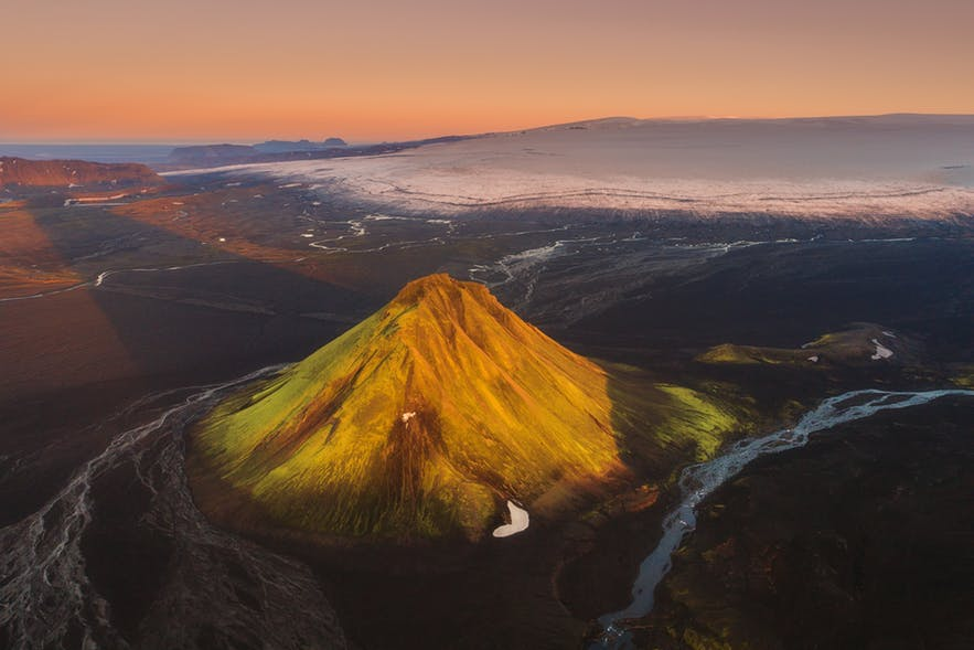 A volcano in a landscape scene that shows sand and rivers - landscape Photography | Everything You Need To Know