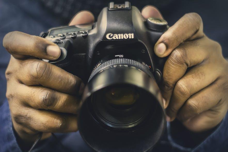 A man's hands hold a digital camera - types of cameras | digital