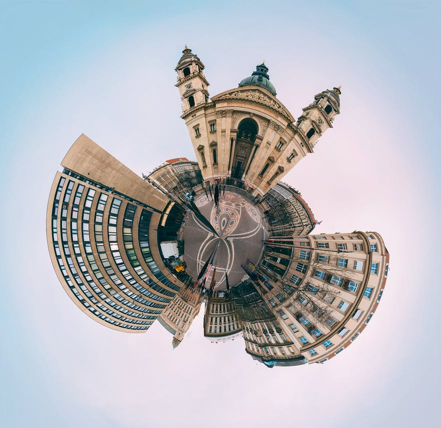 A scene showing buildings with circular distortion - types of cameras | digital