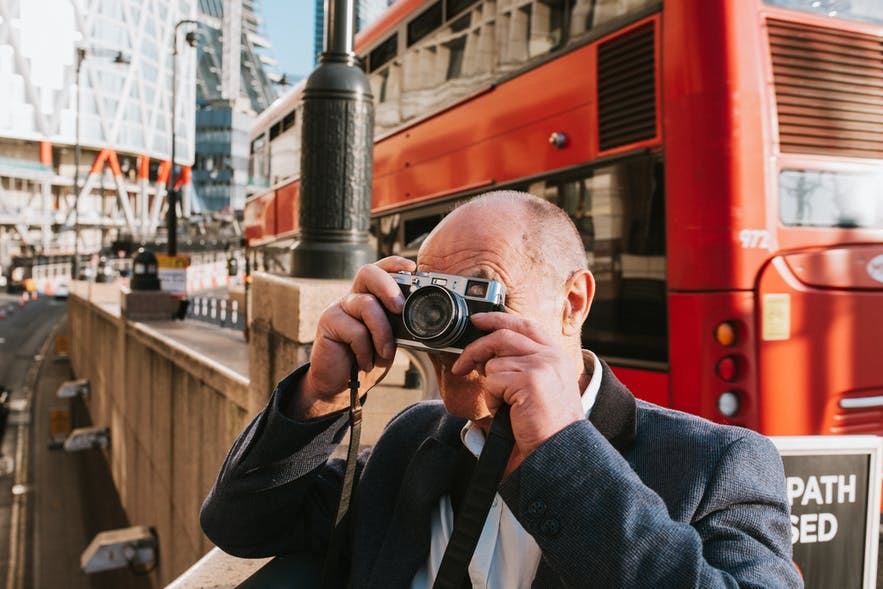 A man shooting with a Fujifilm camera in London.