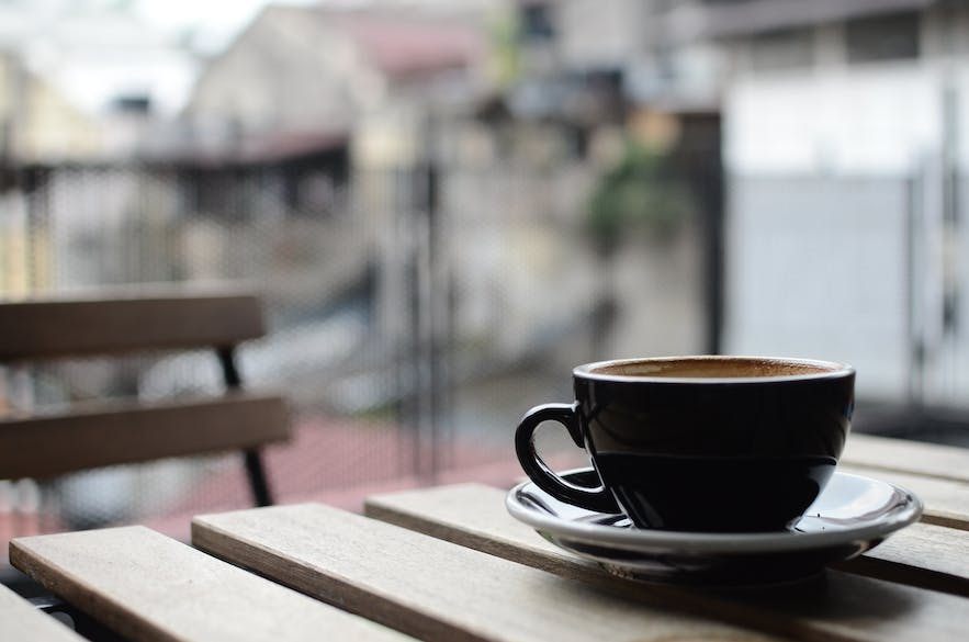 A coffee cup on a table.