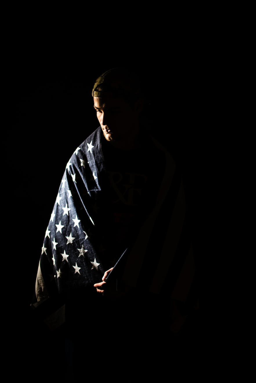 Man draped in stars on a flag