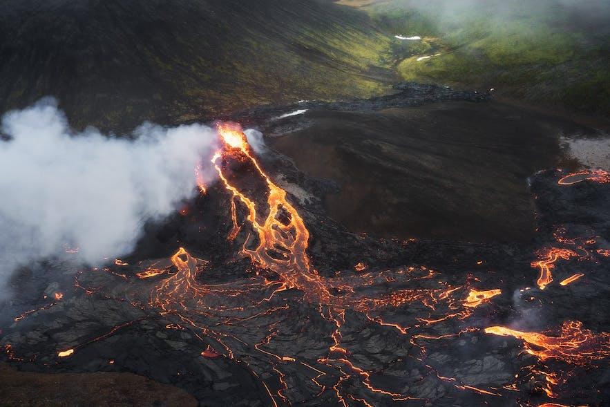 Green moss and orange lava contrast at Geldingadalur.